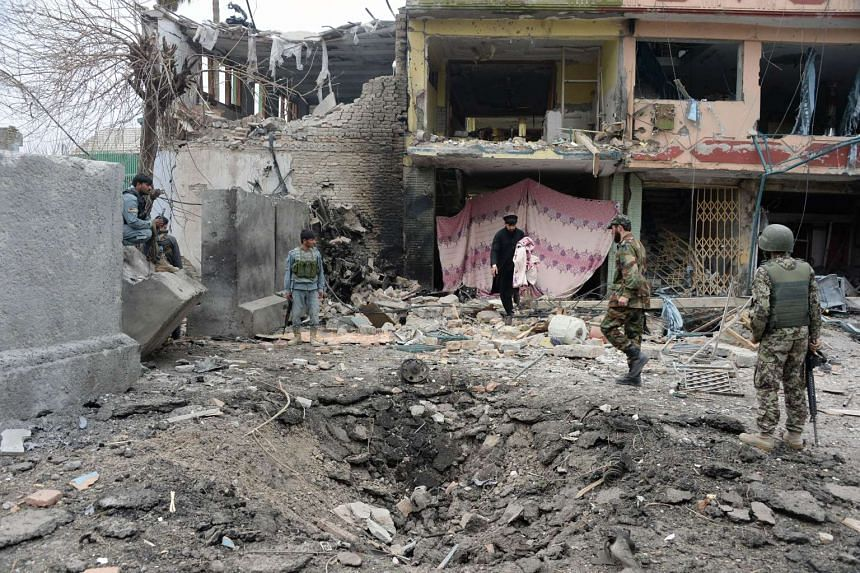 Afghan security personnel inspecting the site of an attack in front of the Indian consulate in Jalalabad on March 2, 2016.