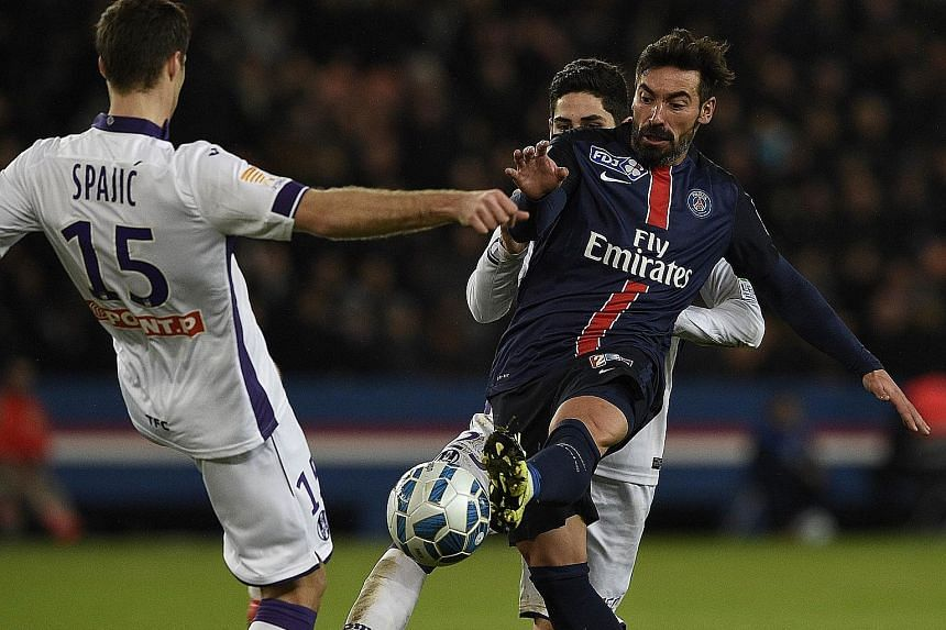Ezequiel Lavezzi vying with Toulouse's Uros Spajic in their French League Cup match in January. The Argentinian spurned offers from Inter, Chelsea and United to move to Chinese side Hebei Fortune.