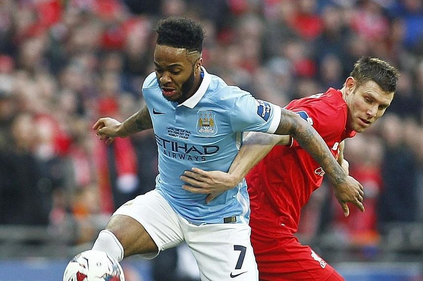 Manchester City's Raheem Sterling (far left) tussling with Liverpool's James Milner during the League Cup final