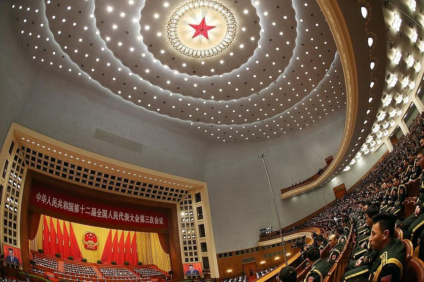 The opening of the 12th National People's Congress at the Great Hall of the People in Beijing last March. This year's NPC and CPPCC meetings come amid concerns over the economy, which faces slowing growth, overcapacity and volatile markets.