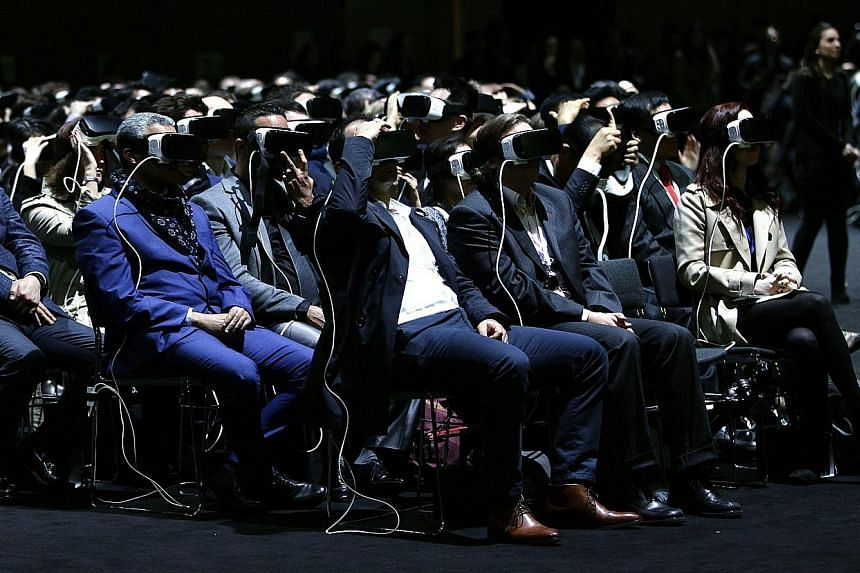People checking out VR goggles during Samsung's presentation on a preview day of the Mobile World Congress in Barcelona, Spain, last week.