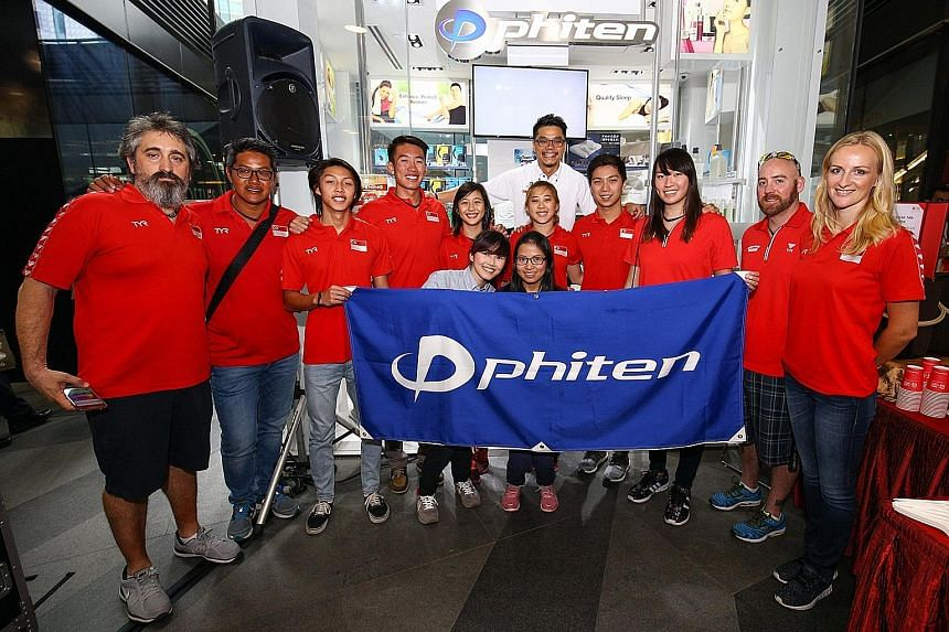 (From left) Swimming head coach Sergio Lopez, water polo head coach Lee Sai Meng, water polo players Darren Lee and Lee Kai Yang, divers Fong Kay Yian and Freida Lim, swimmers Lionel Khoo and Roanne Ho, diving head coach Shannon Roy and synchronised