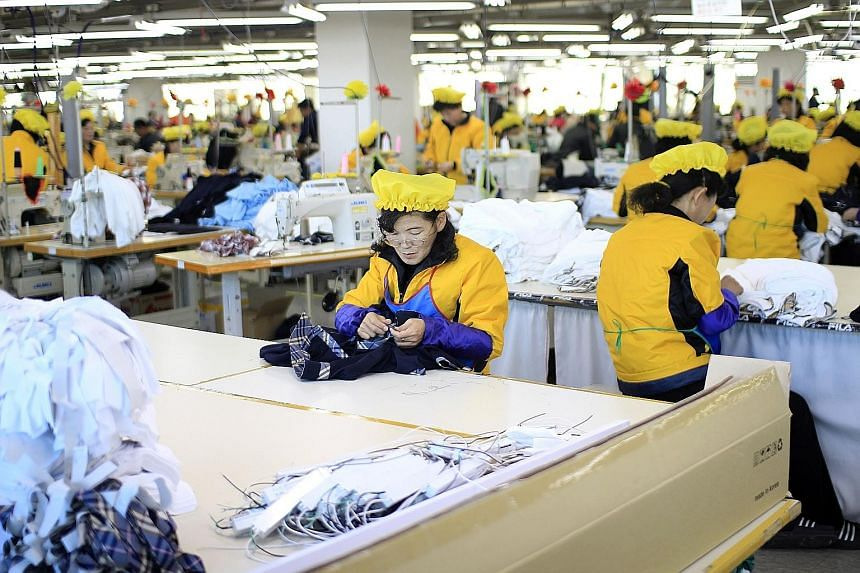 North Korean women working at a garment factory based in the inter-Korean Kaesong Industrial Complex last year.