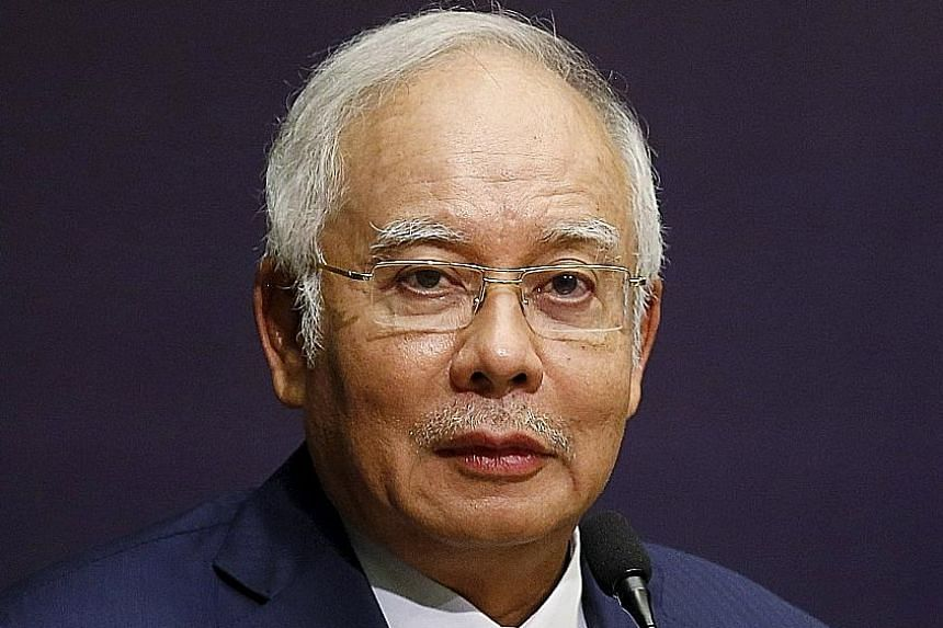 """The US paper was """"repeating the same old allegations"""" against PM Najib (left), said a government spokesman."""