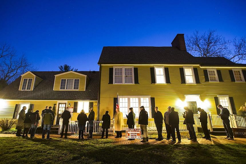 Virginia residents waiting in line in the pre-dawn hours to vote in the Virginia primary at a historic property called the Hunter House at Nottoway Park in Vienna, Virginia, yesterday. Voters were heading to the polls in 12 states and one United Stat