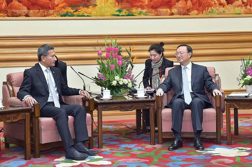 Foreign Minister Vivian Balakrishnan with Chinese State Councillor Yang Jiechi in Beijing yesterday. Singapore's proposal of an expanded Code for Unplanned Encounters at Sea was made as part of the Republic's role as country coordinator for China-Ase