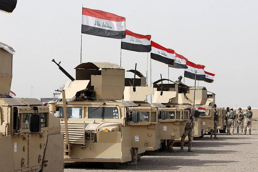 Iraqi security forces at an army base in Camp Taji in Baghdad. The forces are gearing up to retake Mosul from ISIS militants.
