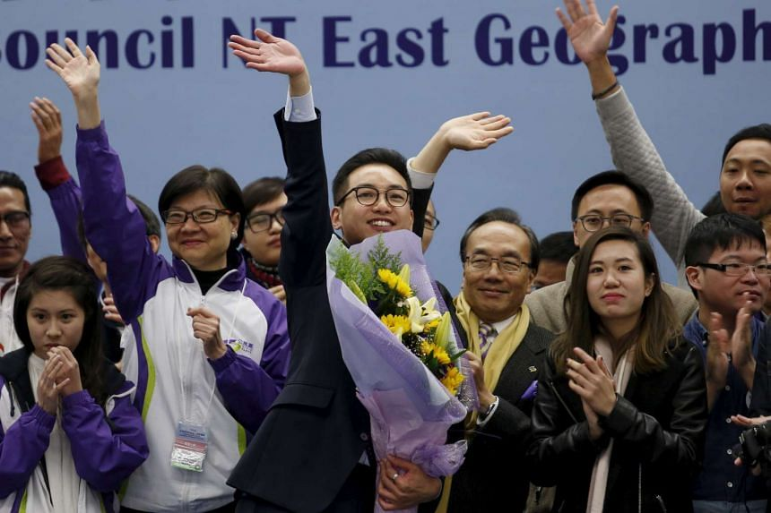 Mr Alvin Yeung (centre), a candidate from the Civic Party, celebrating with supporters after winning the Legislative Council by-election in Hong Kong, China, on Feb 29, 2016.