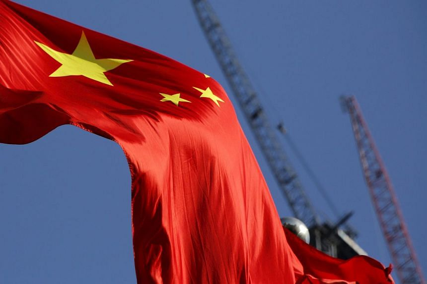 A Chinese flag flying in front of a construction site in Beijing on Jan 26.