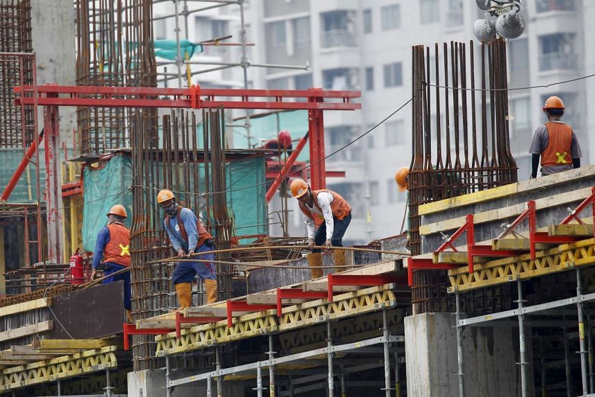 Labourers at a construction site in Jakarta on Feb 4.