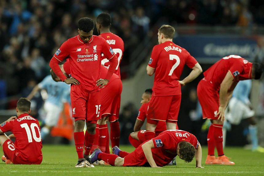 Liverpool players following their penalty shoot-out loss to Manchester City during the League Cup final.