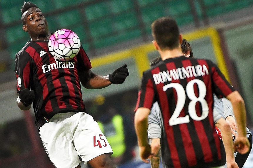 Milan's Mario Balotelli (left) in action during the Coppa Italia semi final second leg football match between AC Milan and US Alessandria.