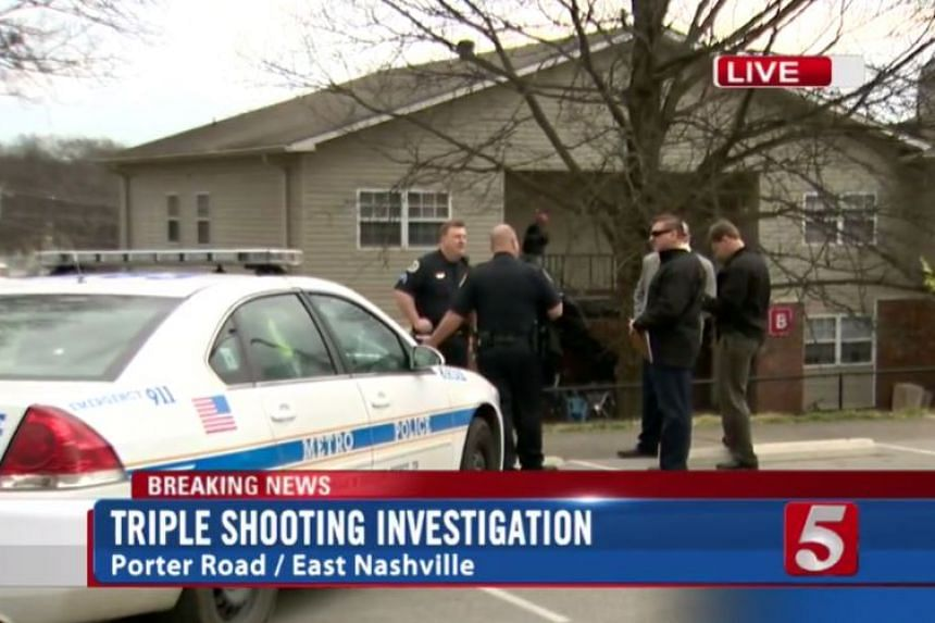 Police officers gathered near the apartment at Porter Road in East Nashville, where the shooting took place.