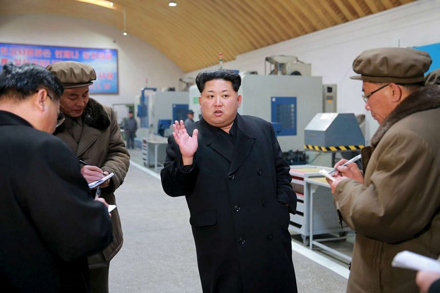 North Korean leader Kim Jong Un visits a machinery factory in a photo released March 2, 2016.