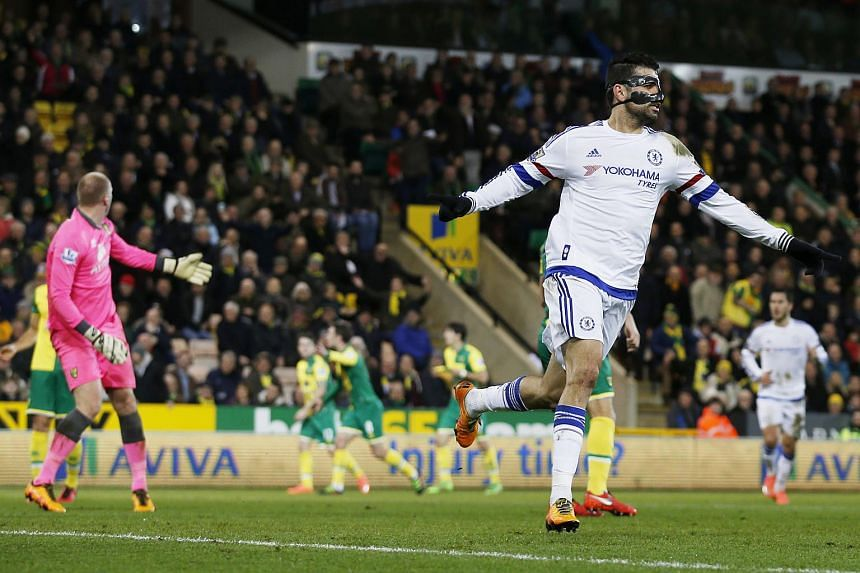 Diego Costa celebrates scoring the second goal in the English Premier League football match between Norwich City and Chelsea.