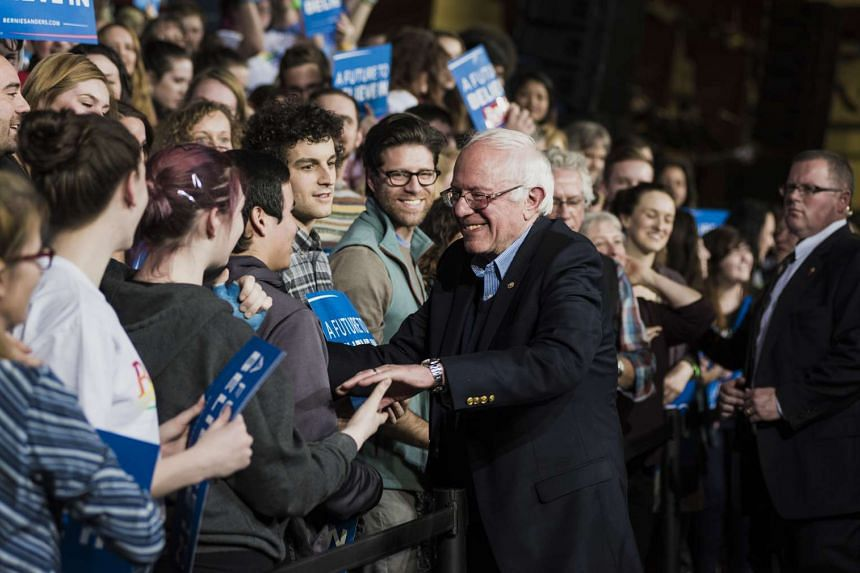 Senator Bernie Sanders, an independent from Vermont and 2016 Democratic presidential candidate, greets attendees during a Super Tuesday night rally in Essex Junction, Vermont on March 1.