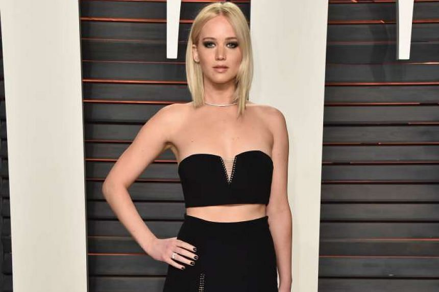 Actress Jennifer Lawrence (above) shows up at the Vanity Fair Oscar Party in Beverly Hills in a sexy black number, while singers Gwen Stefani and Blake Shelton make their red-carpet debut as a couple at the same event.