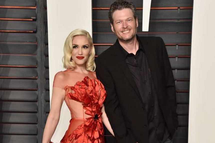 Actress Jennifer Lawrence shows up at the Vanity Fair Oscar Party in Beverly Hills in a sexy black number, while singers Gwen Stefani and Blake Shelton (both above) make their red-carpet debut as a couple at the same event.