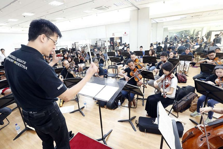 Conductor Adrian Tan leading the Braddell Heights Symphony Orchestra in a rehearsal.