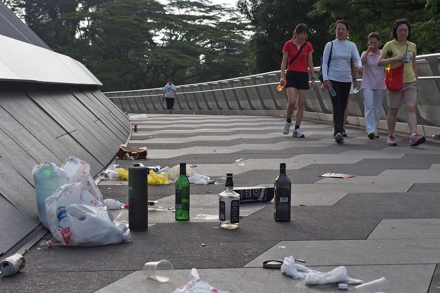 Empty bottles litter the Alexandra Arch bridge in Alexandra Road. Since the community volunteer programme began in 2013, about 340 volunteers have engaged 2,500 litterbugs.