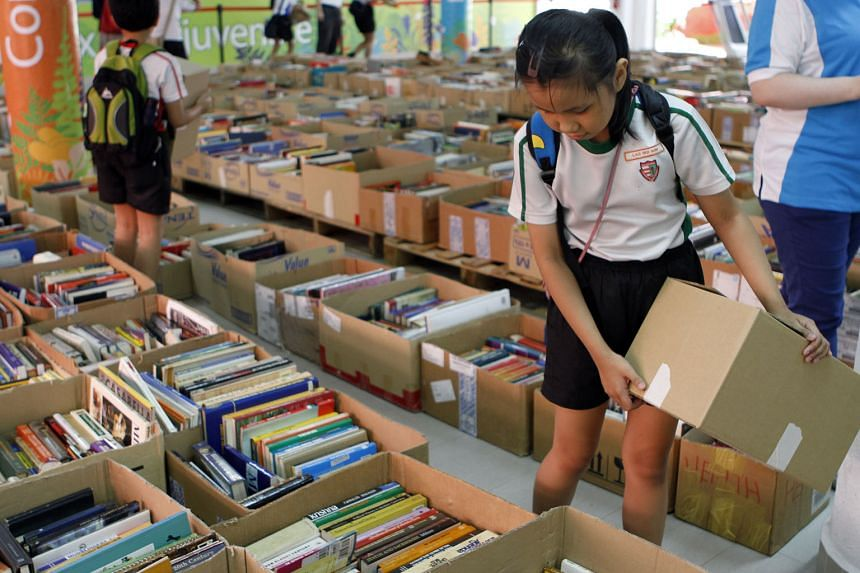 Schoolchildren browsing at the book carnival organised by the All Saints Home. The four-day event raised almost $30,000, including donations for four nursing homes.