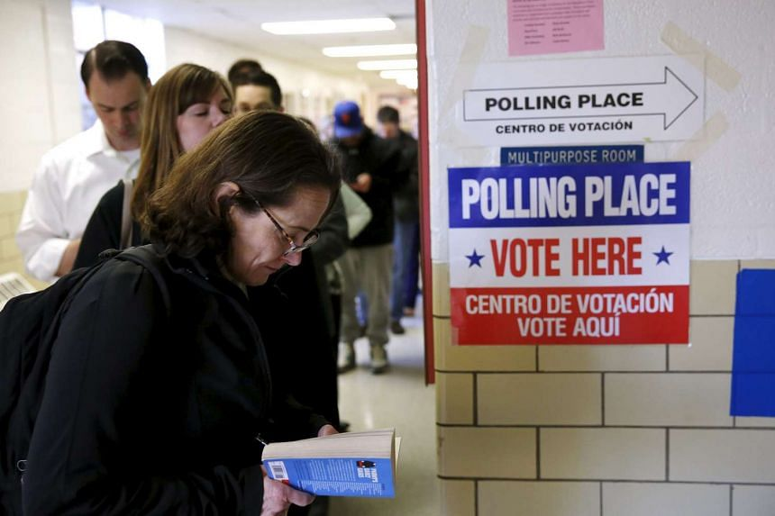 Virginia voters line up early to cast their ballots in Super Tuesday elections at the Wilson School in Arlington, Virginia, on March 1.