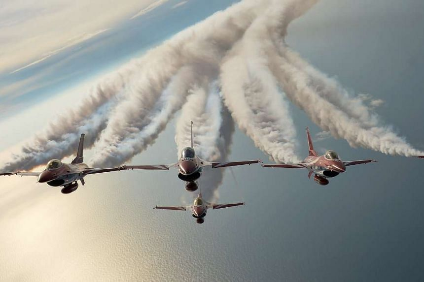 ST photojournalist Alphonsus Chern won the Feature Picture of the Year award for this shot of the Black Knights - the Republic of Singapore Air Force aerobatics team - flying in formation over the South China Sea.