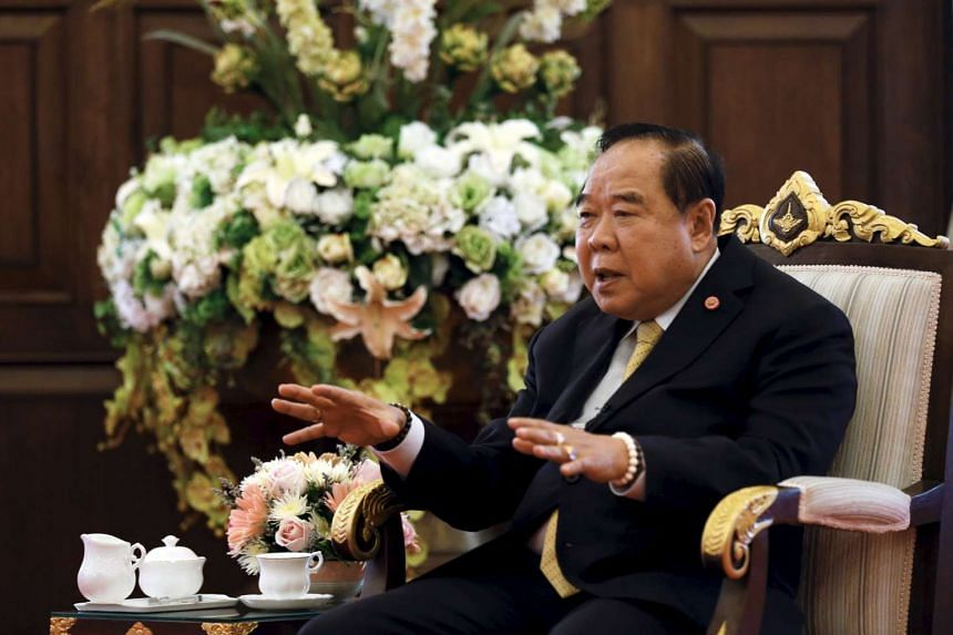 Watana Muangsook has been charged with breaking computer crime laws after he accused Thai Deputy Prime Minister and Defence Minister Prawit Wongsuwan (above) for making sexist remarks.