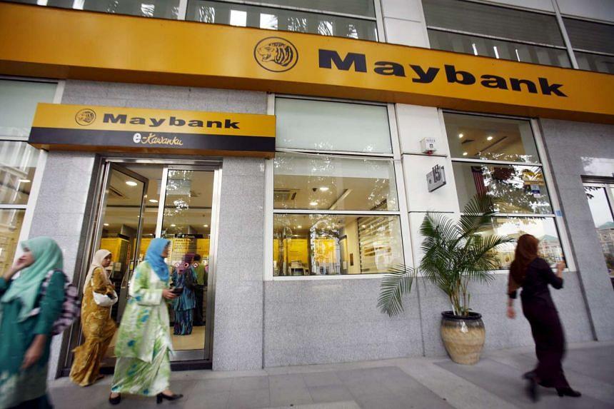 Customers at a branch of Malaysia's Maybank in Putrajaya.