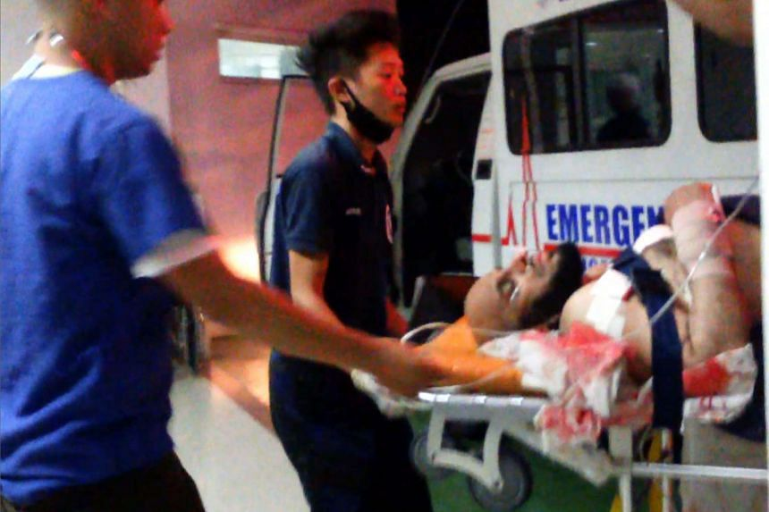 This screengrab taken from a video shows medical personnel transferring Saudi preacher Sheikh Aaidh al-Qarni (right) into a hospital in Zamboanga, Philippines.