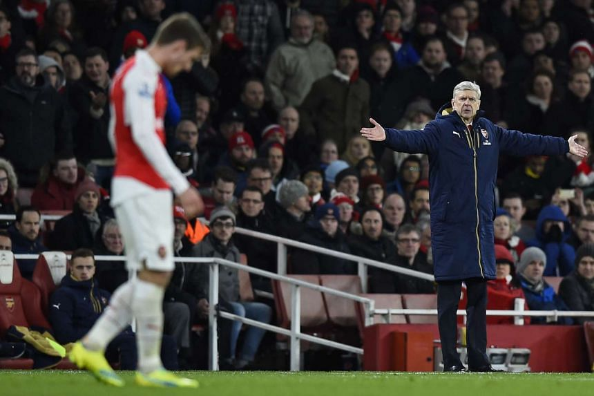 Arsene Wenger gestures during the English Premier League football match between Arsenal and Swansea City.