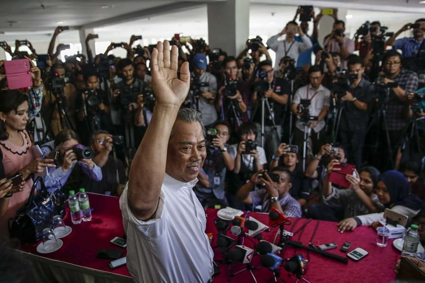 Former Malaysian Deputy Prime Minister and former Umno deputy chief Muhyiddin Yassin waving during a press conference in Kuala Lumpur, Malaysia, on March 3, 2016. Tan Sri Muhyiddin has been suspended as deputy prime minister and Umno deputy chief for