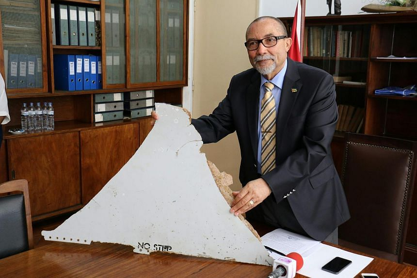 Joao de Abreu, President of Mozambique's Civil Aviation Institute (IACM), holds a piece of suspected aircraft wreckage found off the coast of Mozambique.