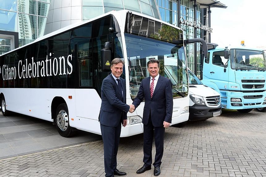 Mr Ahlden (left), head of Daimler's regional centre for commercial vehicles in Singapore, with Mr Bernhard, a member of the automotive giant's board.