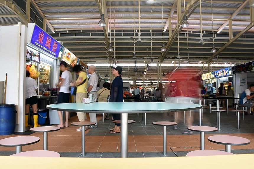 Ghim Moh Market and Food Centre re-opened on Tuesday after a year and a half of renovations, boasting floors scrubbed clean of years of grime, wider walkways and better ventilation.
