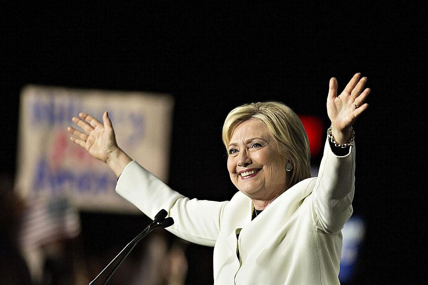 Mr Donald Trump speaking to the media at Palm Beach, Florida, and Mrs Hillary Clinton at a rally in Miami on Super Tuesday. While both emerged as clear favourites, Mrs Clinton's path to secure the Democratic nomination is arguably less challenging th
