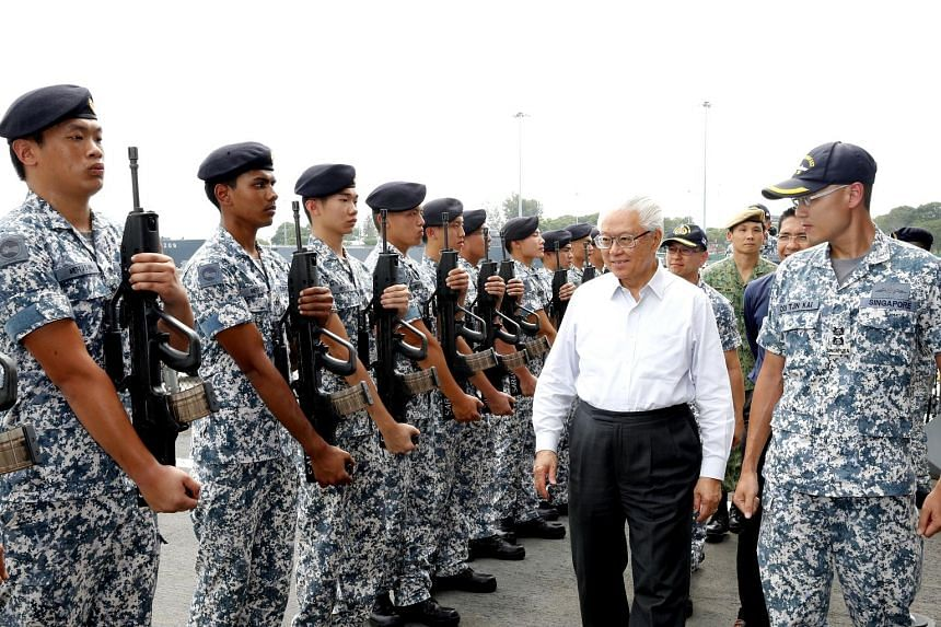 President Tony Tan inspecting the guard yesterday at Changi Naval Base. This is his first visit to the base since being elected in 2011. Dr Tan was the Defence Minister between 1995 and 2003.