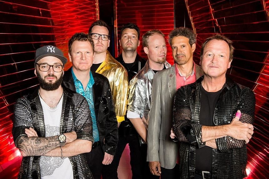 Singer-bassist Mark King (far right) with members of Level 42.