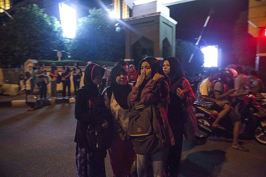 Residents of Padang seeking safety in the streets after a strong earthquake shook the city in West Sumatra, Indonesia, last night. The magnitude-7.8 earthquake sparked panic, but there were no immediate reports of damage or casualties on Indonesia's