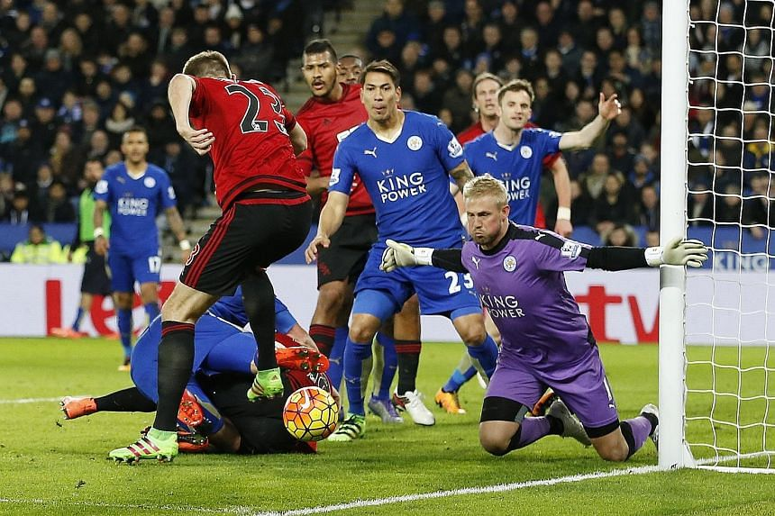 Leicester goalkeeper Kasper Schmeichel getting down to block a shot by West Brom's Gareth McAuley during the 2-2 draw on Tuesday.