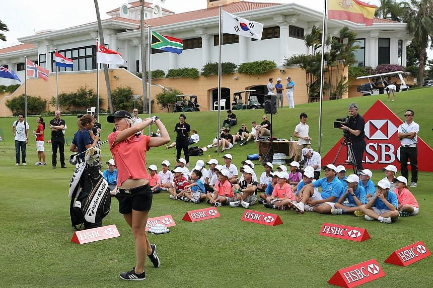 England's Melissa Reid took time off from her preparations for the HSBC Women's Champions to conduct a coaching clinic yesterday afternoon at Sentosa Golf Club. Held in conjunction with Fox Sports Academy, the HSBC Junior Coaching Clinic attracted 33