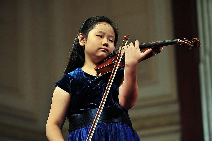 Susan Tang (left) has performed the Butterfly Lovers Violin Concerto with her father, Chinese conductor Tang Muhai (below), more than 10 times.
