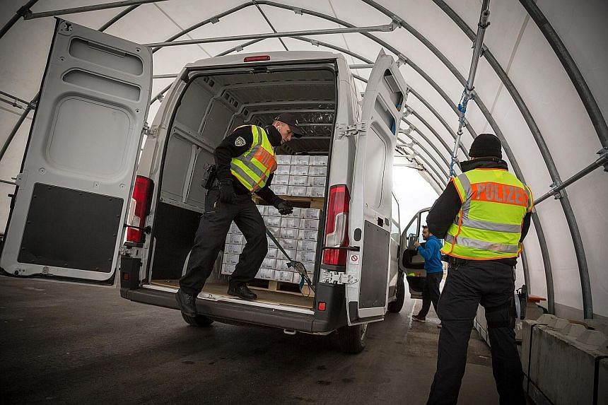 A police checkpoint on the A8 motorway in Piding, Germany, on the border with Austria. Across Europe, new border controls meant to control the migration crisis have become a major drag on the economy, frustrating commuters and shipping companies alik