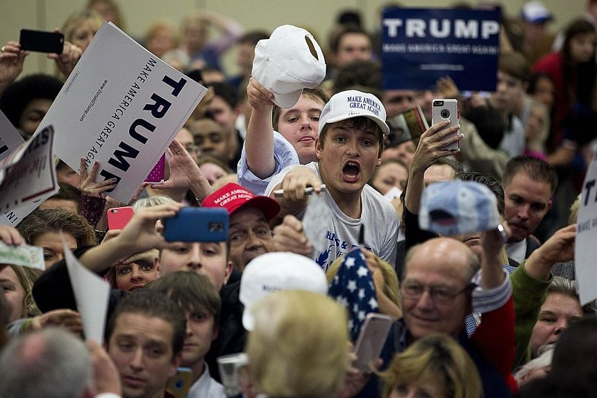 Supporters eagerly waiting for Mr Donald Trump's autograph at the Kentucky International Convention Centre in Louisville, Kentucky, on Tuesday. Interviews with Trump voters revealed a diversity of support that could sustain him as a front runner in t