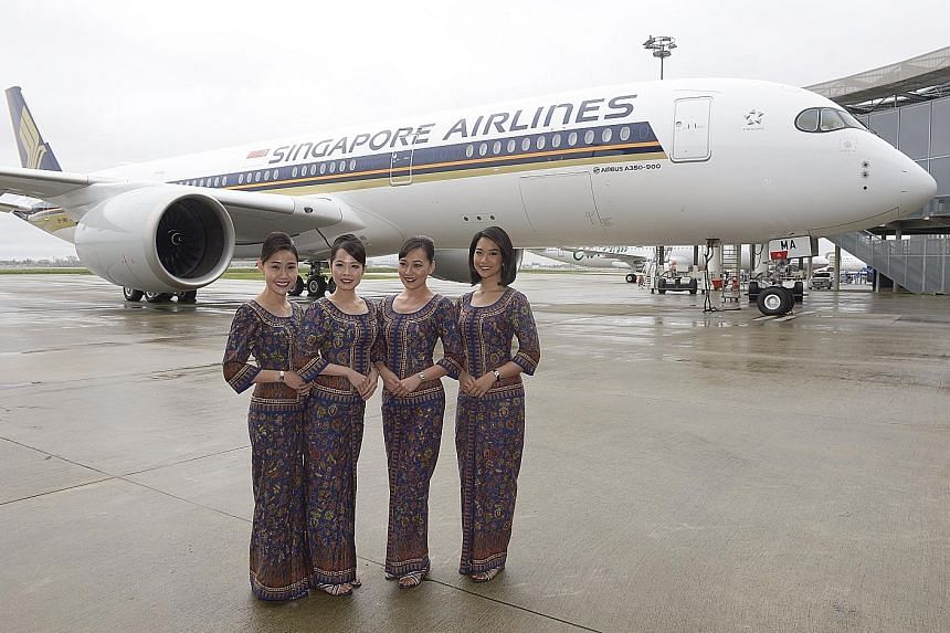 (From left) Singapore Girls Celeste Xu, Ashlyn Ong, Jasmine Sie and Sarah Khairul Anuar in front of Singapore Airlines' new A350-900 at the Airbus Delivery Centre in Toulouse yesterday. The long-haul jetliner is scheduled to arrive at Changi Airport