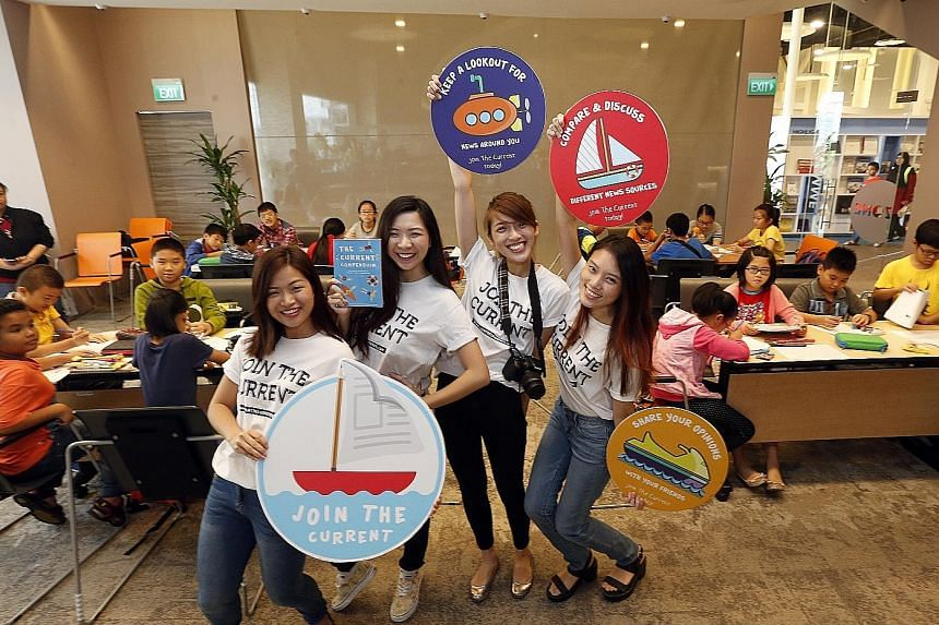 The team of (from left) Ms Natalie Huam, Ms Lynette Teo, Ms Fiona Tan and Ms Miranda Yeo, all aged 22, conducting a workshop at Pasir Ris Public Library. They aim to reach children from lower-income families with their news literacy campaign because