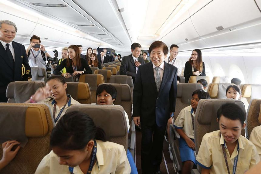 Transport Minister Khaw Boon Wan touring the interior of SIA's new Airbus 350.