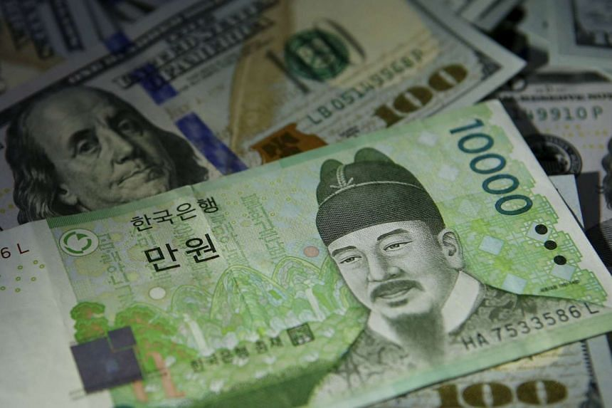 South Korean 10,000 won notes are seen lying on US $100 bills.