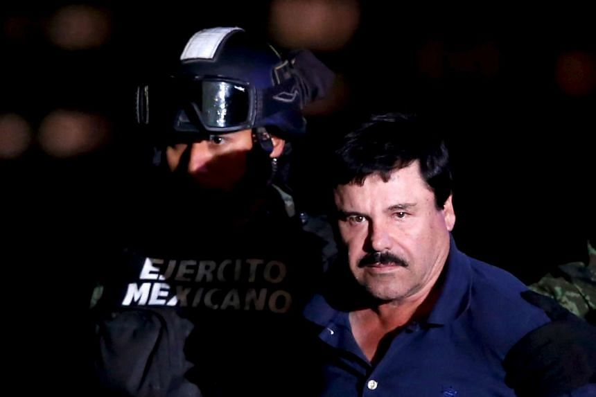 Guzman being escorted by soldiers after his recapture on Jan 8, 2016.