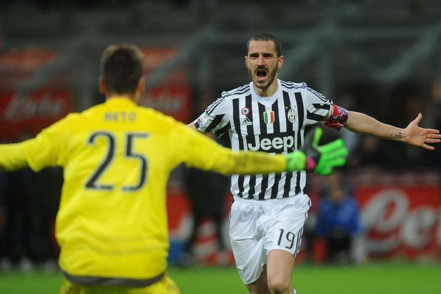 Leonardo Bonucci celebrates after scoring the winning penalty during the Italian Cup second leg semi final football match between Inter FC and Juventus FC.